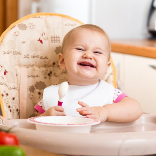 Baby smiling with spoon